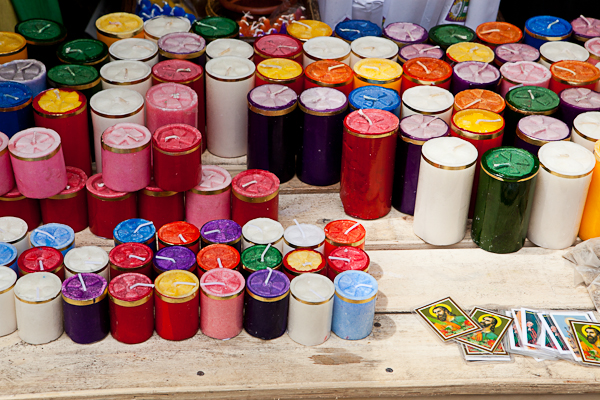 Candles for sale outside of a church in Quito, Ecuador
