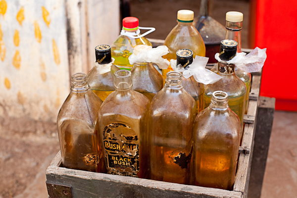Black-market gasoline sold in whiskey bottles are a common sight in Siem Reap